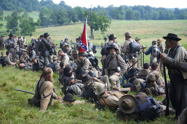 Actors playing Confederate soldiers congregate at a wood's edge awaiting orders to charge during a reenactment of The Battle of Little Roundtop during the Blue Gray Alliance events marking the 150th anniversary of the Battle of Gettysburg, in Gettysburg, Pennsylvania June 30, 2013.