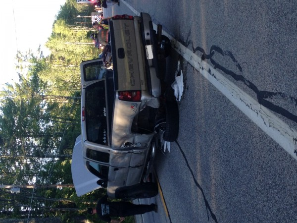A pickup truck sits on the Carl Broggi Highway in Lebanon after a head-on collision on Tuesday.