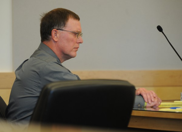 Warren Dome sits in court at the Penobscot Judicial Center on Tuesday as his attorney Hunter Tzovarras addresses the jury during closing arguments in his criminal threatening with a dangerous weapon trial.