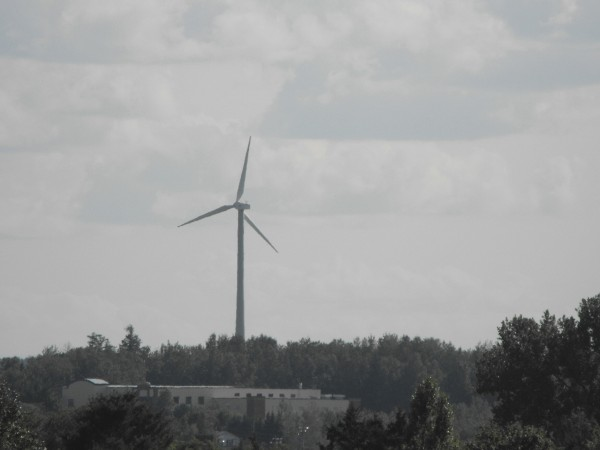 The University of Maine at Presque Isle's windmill is pictured from a distance on the city's skyline. Windmills, both for residential and business use, are becoming familiar sights in Aroostook County.