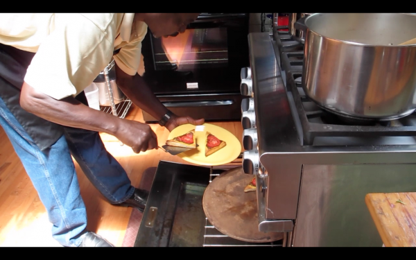 Alva Lowe removes tomato pastry tarts from the oven at The Kitchen Garden Restaurant in Steuben.