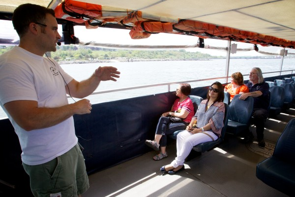Tour guide Derek Meader points out the sights while narrating the Casco Bay portion of the amphibious Downeast Duck tour around Portland Thursday afternoon.