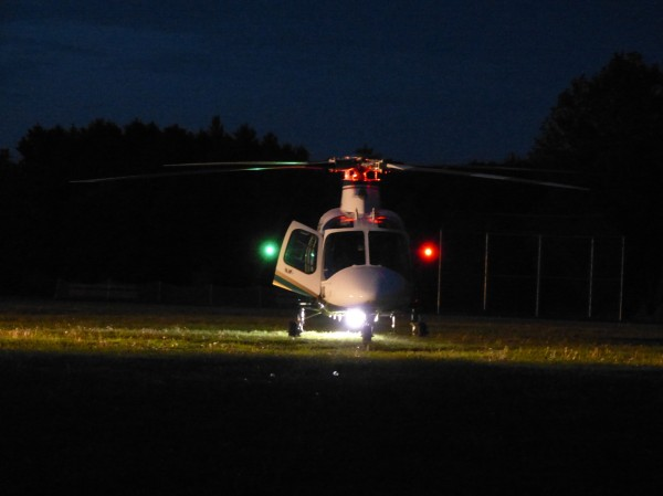 A LifeFlight helicopter landed in an open grass area near the baseball field at Bowdoin Central School Saturday to meet rescuers with a motorcycle crash patient.