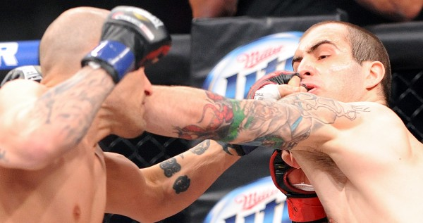 Jon Lemke (left) of Bangor delivers a left to the face of Auburn's Jesse Erickson during Bellator MMA fight on March 21 at the Androscoggin Bank Colisee in Lewiston. Lemke went on to win the match. Lemke will be fighting in the Nations Collide: Canadian Invasion show on Friday, July 12 at Darling's Waterfront Pavilion in Bangor.