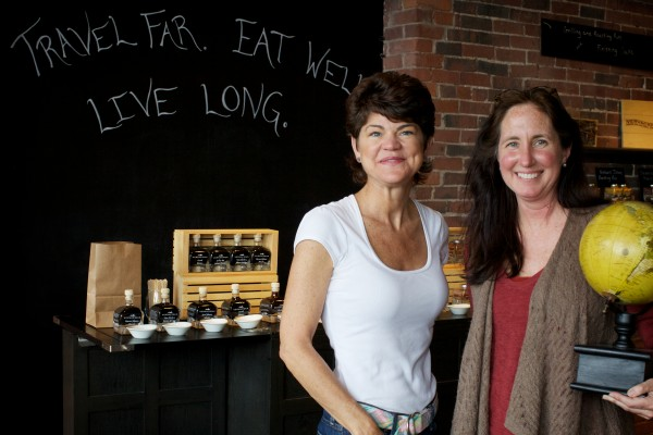 Pamela Laskey, of Portland Foodie Tours, stands with Heidi Stanvic in Vervacious, Stanvick's travel-inspired fancy food shop on Commercial Street in Portland. The shop is one of the stops on the tour.