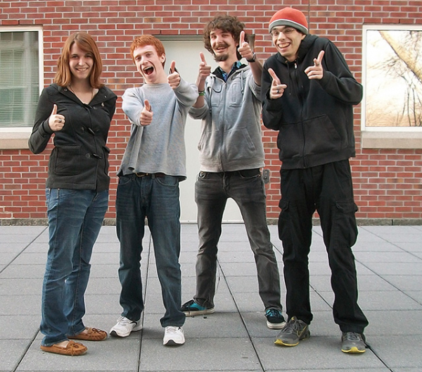 The team from High Class Kitsch, a fledgling indie game developer, Jill Sauer (from left) , Mike Frankfort, Ryan Casey and Alex Thornton-Clark, poses for a photo in Worcester, Mass., where they got their start as Worcester Polytechnic Institute students and hope to grow their business. Casey, a Veazie native and John Bapst Memorial High School graduate, said he has been dubbed the &quotpublic face&quot for the team since it began receiving attention from national gaming media outlets.