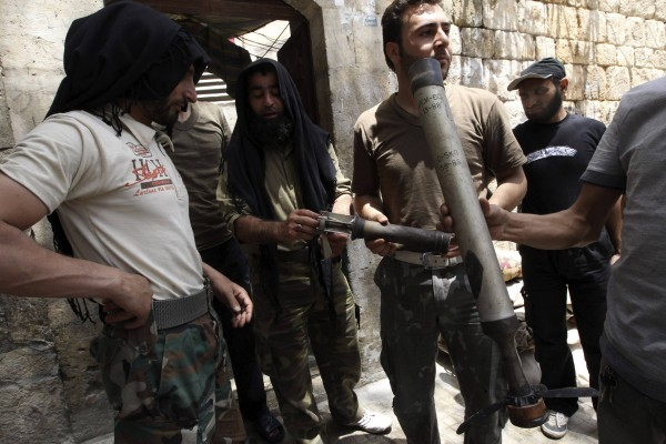 Free Syrian Army fighters display what they said were shells used by forces loyal to Syria's President Bashar al-Assad during clashes with them in Aleppo's Karm al-Jabal district on Sunday.