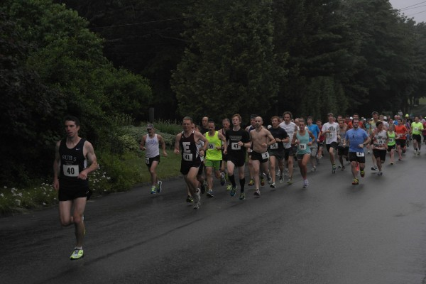 A group of runners race in the 38th annual Tour du Lac that took place Saturday, June 29, 2013.