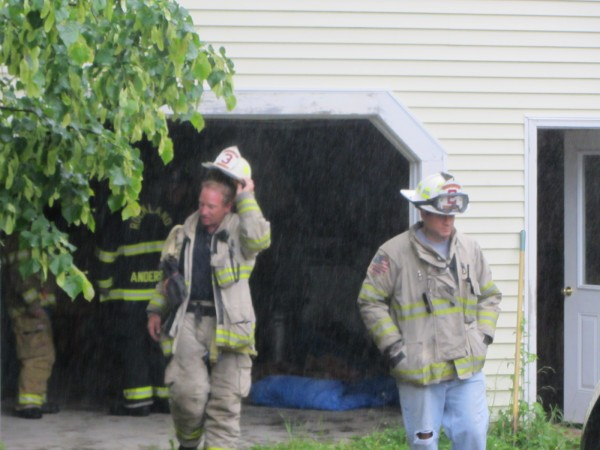 Rockland Fire Department Assistant Chiefs Kenneth Elwell (left) and Adam Miceli leave a residential garage on New County Road in Rockland where a minor fire occurred Tuesday evening.