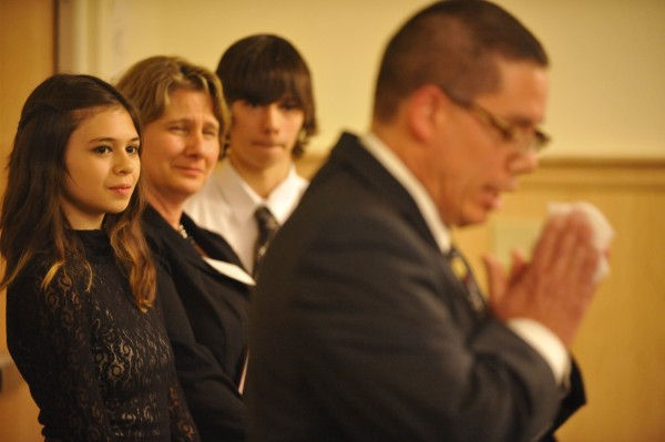 Nicole Maines (from left), her mother, Kelly Maines, and her twin brother, Jonas, listen to Wayne Maines (right) as he delivers a stirring speech in 2011 about their experience in helping Nicole seek justice and acceptance as a transgender youth.