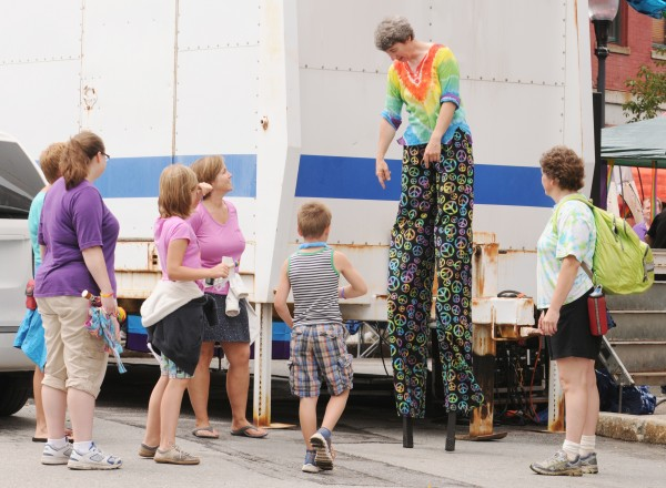 Rissa Moore of Orono shows off her stilt walking ability to people in attendance at the Bangor Pride Festival in West Market Square on Saturday.