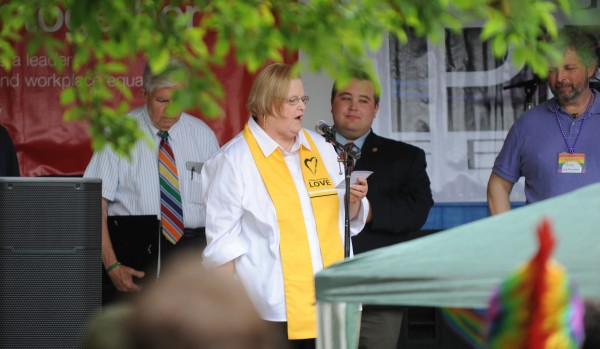 The Reverend Becky Gunn offers an invocation during the opening of the Bangor Pride Festival in West Market Square on Saturday.