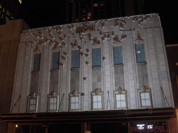 With projection mapping technology, virtual, 3D &quotpinballs&quot appear to run across the the facade of a historic Orlando building.