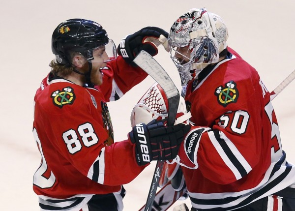 Chicago Blackhawks' Patrick Kane (left) celebrates with goalie Corey Crawford after the Blackhawks defeated the Boston Bruins 3-1 in Game 5 of their NHL Stanley Cup Finals series in Chicago Saturday night, June 22, 2013.