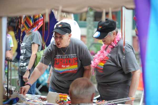Sandra Wallace of Bangor, left, and her partner of 33 years, Sue Cross, shop at one of several venders at the Bangor Pride Festival in West Market Square on Saturday.