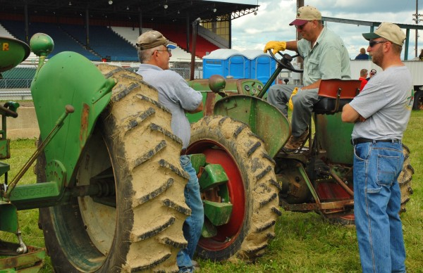 Southern Maine tractor fans and collectors Mike Pratt (left), Dale Fairbanks (center) and Mike Fairbanks were at the Northern Maine Fairgrounds over the weekend with their restored Oliver tractors to take part in the Old Iron Roundup.