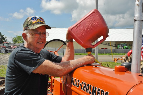 Washburn tractor collector Richard Carter gets his antique Allis-Chalmers ready for the tractor pull this weekend in Presque Isle at the Old Iron Roundup.