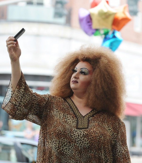 A drag queen who gave his name as LaWanda takes a picture of himself with his cell phone during the Bangor Pride Festival in West Market Square on Saturday.