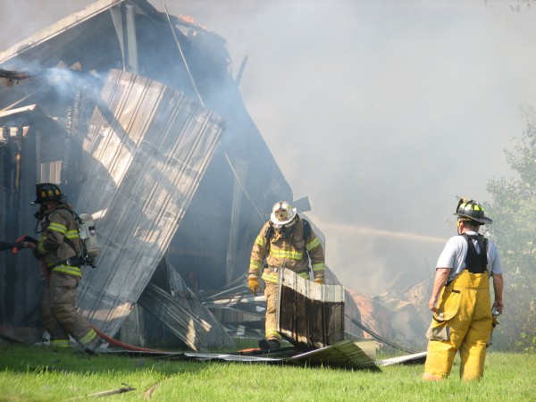 Firefighters try to contain a fire in a storage rental unit building on Route 172 in Sedgwick on Saturday.