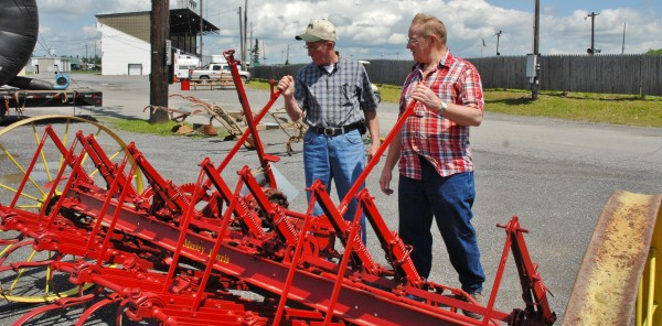 A big part of the Old Iron Roundup in Presque Isle over the weekend was showing off restored antique machinery. Dale Campbell (left) explains what went into restoring and running an old Massey Harris harrow to Rodney Cory.