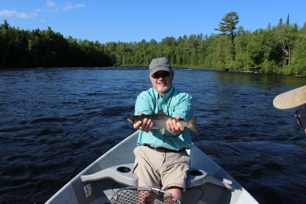 John Craig of Bucksport shows off the landlocked salmon he caught while fishing with guide Dan Legere on the East Outlet of the Kennebec River on June 21, 2013.