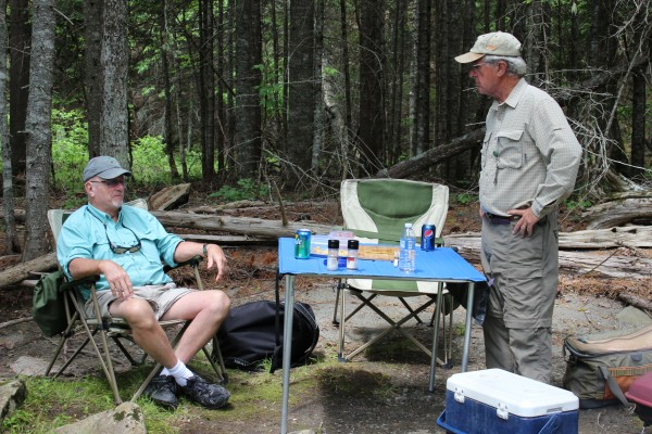 John Craig of Bucksport (left) talks with guide Dan Legere of Greenville during a drift boat trip on the East Outlet of the Kennebec River on June 21, 2013.