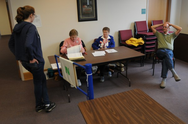 &quotI cannot remember a voting day as slow as this.&quot  said election clerk Dorothy Plummer on Tuesday. Plummer, second from left, checks Norah Bird, left, in as election clerk Carol Mower and election warden Geoff Gordon watch at the Orono Municipal building on Tuesday.