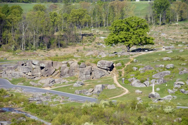 The Devil's Den is the local name applied to the mass of jumbled boulders located at the south end of Houck's Ridge at Gettysburg, Pa. The Devil's Den was the scene of intense fighting involving the 4th Maine Infantry Regiment and other Union and Confederate regiments on Thursday, July 2, 1863.