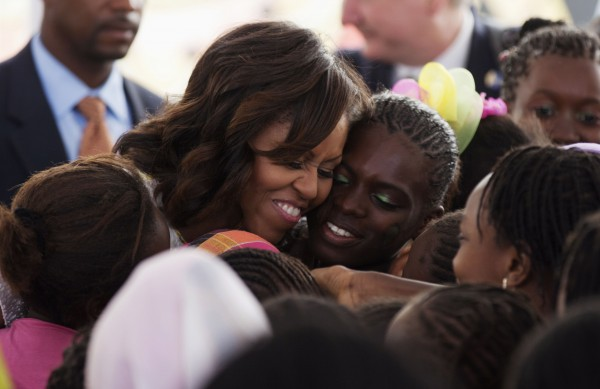 U.S.first lady Michelle Obama hugs students at Martin Luther King middle school, an all-girls school in Dakar, Senegal June 27 2013. U.S. President Barack Obama Obama and his wife Michelle are visiting Senegal until June 28 before travelling to South Africa and Tanzania.