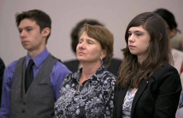 Nicole Maines (right) stands with her brother Jonas Maines and her mother, Kelly Maines, during a hearing before the Maine Supreme Court, Wednesday, June 12, 2013, in Bangor.