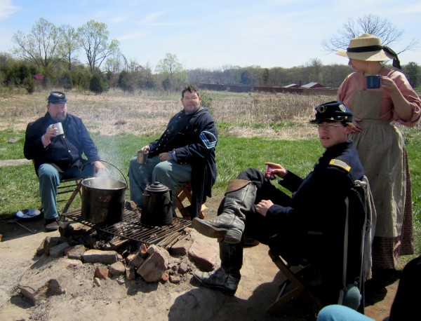 Re-enactors from the 9th Pennsylvania Reserves talk around the campfire during a recent encampment near the Pennsylvania Memorial at Gettysburg National Military Park in Gettysburg, Pa.