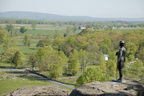 The statue of Union Gen. Gouverner K. Warren stands atop the rugged rocks of Little Round Top at Gettysburg National Military Park in Pennsylvania. This site overlooks the scene of fighting on July 2-3, 1863; in the middle distance is the Cordori Farm, around which Virginia troops passed while participating in Pickett's Charge.