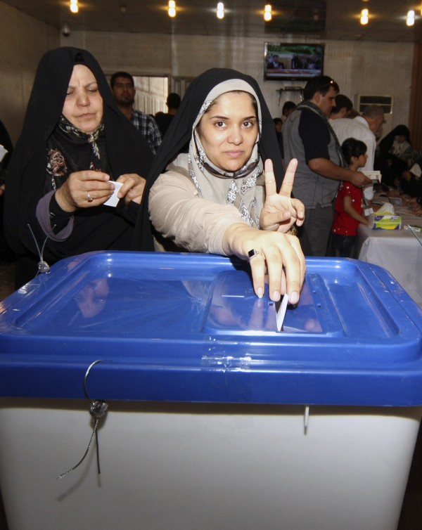 An Iranian woman gestures as she cast her ballot for the Iranian presidential election at the Iranian Consulate in Kerbala, 110 km (70 miles) south of Baghdad, June 14, 2013.  Millions of Iranians voted to choose a new president on Friday, urged by Supreme Leader Ayatollah Ali Khamenei to turn out in force to discredit suggestions by arch foe the United States that the election would be unfair.
