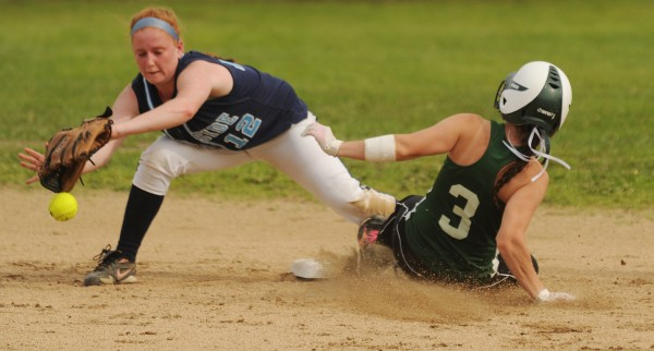 Oceanside's Molly Mellor drops the ball as Old Town's Samantha Mills slides safely into second base during 3rd inning action on Monday at Old Town.Oceanside won 5-2.