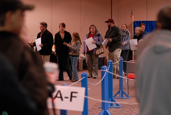 A steady stream of voters wait return their ballots at the Bangor Civic Center in the 2008 election.