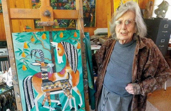 Artist and author Dahlov Ipcar shows her latest painting in her Georgetown studio on Wednesday.