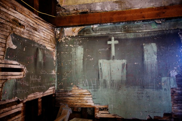 A cross hung on a wall during its days as an appartment building marks a fire in the 1970's at the 185-year-old Abyssinian Meeting House in Portland, which was built before the Civil War by free African Americans.