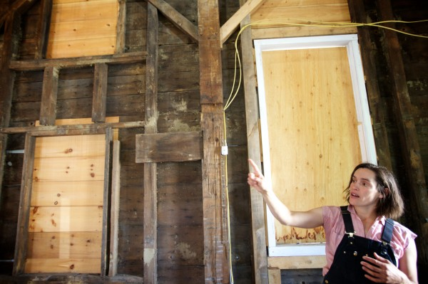 Preservation carpenter Jessica Milneil points out restoration work at the 185-year-old Abyssinian Meeting House in Portland Wednesday.