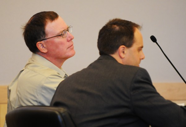 Warren Dome (left) sits with his attorney Hunter Tzovarras during opening arguments on Monday at the Penobscot Judicial Center in Bangor.