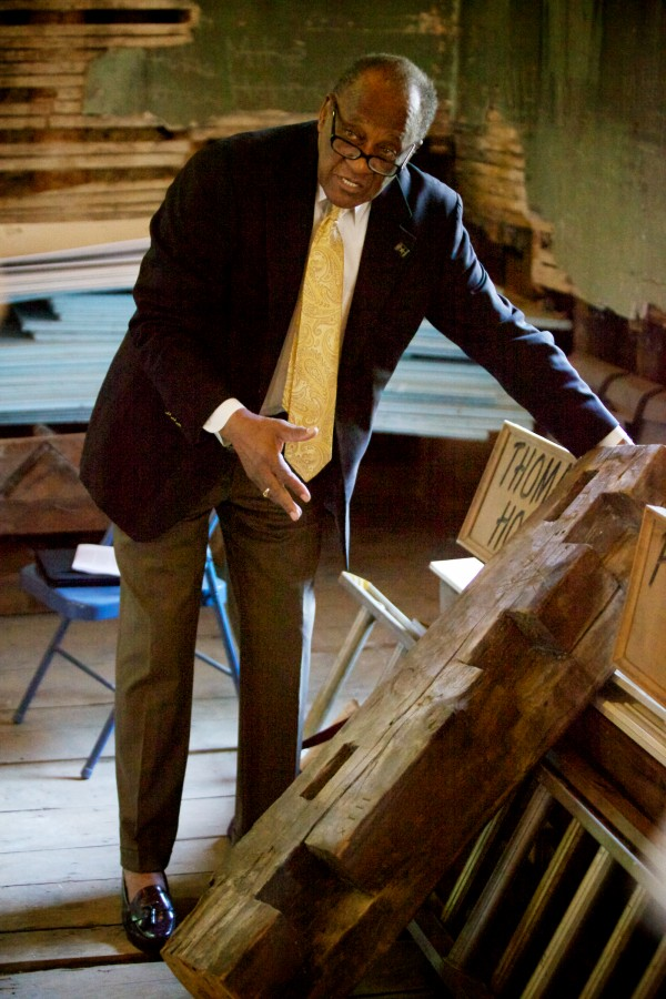 Leonard Cummings, chairman of the Committee to Restore the Abyssinian Meeting House, shows off a bit of the original sill Wednesday at a press conference announcing the 185-year-old church's addition to the National Trust for Historic Preservation'€™s 11 &quot€œMost Endangered Historic Places&quot list.