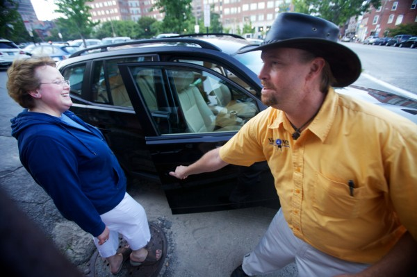 Don Saccone of Valet4ME opens the door for Mandy Houston outside Zapoteca restaurant in Portland on Aug. 2, 2012, after retrieving her car.