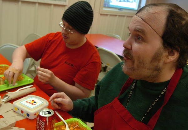 After preparing and serving lunch at the Salvation Army in Bangor, Kenneth Pelkey (right) of Howland and Herbert Skidgel of Bangor sit down to enjoy their own lunch on Wednesday, Jan. 26, 2011. Pelkey and Skidgel are developmentally disabled and participants in the Downeast Horizons Bangor Day Program. &quotThe more you help people, the more they feel good inside,&quot said Skidgel of the volunteer work Downeast Horizon clients do on a monthly basis by planning, serving and cleaning up at The Salvation Army.