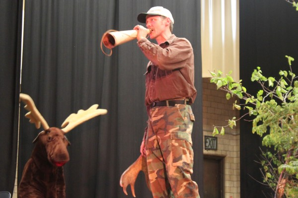Eric Ward of Greenville Junction demonstrates a female moose call during the 2013 Moose Calling Finals organized by The Maine Professional Guides Association and held at Greenville High School during the 2013 Moose Lottery Festival. Ward won third place and a prize of $200.