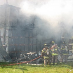 Sedgwick fire destroys large storage building with cars inside