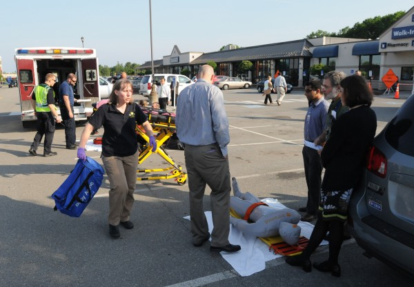 First responders and participants in a mock disaster drill attend to an inflatable victim in the parking lot of the EMMC Healthcare Mall on Union Street in Bangor on Tuesday. Numerous law enforcement and rescue departments took part in a planned community-wide emergency preparedness drill.