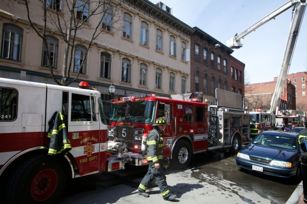 Portland firefighters respond to a two-alarm fire at 86 Exchange St. in the city's Old Port on April 22.