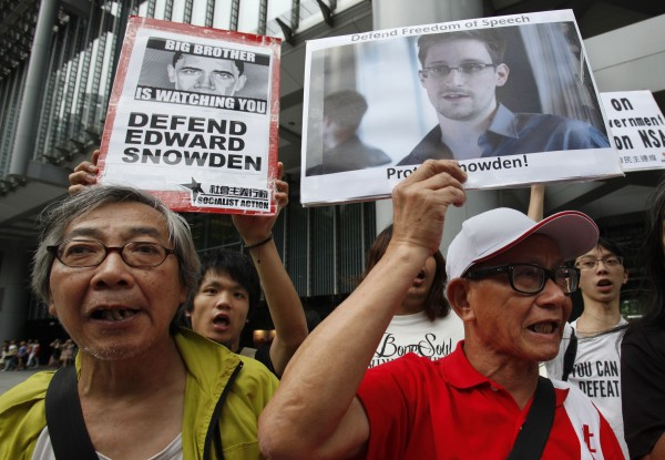 Protesters in support of Edward Snowden, a contractor at the National Security Agency (NSA), chant slogans before marching to U.S. Consulate in Hong Kong in this June 13, 2013 file photo. Snowden left Hong Kong on a flight for Moscow on June 23, 2013 and his final destination may be Ecuador or Iceland, the South China Morning Post said.