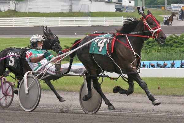 Billy &quotZeke&quot Parker drives Western Mac to victory during the June 27 harness racing card at Monticello Raceway in New York. The Sanford native is closing in on his 11,000th career victory.