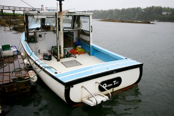 The Queen Tut sits safely at a dock on Great Island in Harpswell Tuesday after being refloated. It sank Saturday after foundering on a ledge with 90-year-old Philip Tuttle aboard.