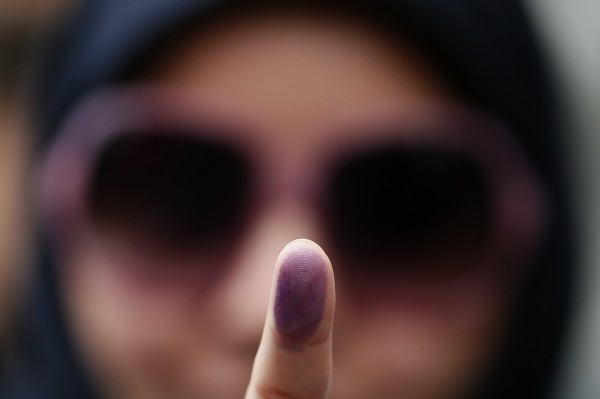 Voter Zeynab shows the ink stain on her finger, to prove that she has voted, outside the Iranian consulate in central London on Friday.